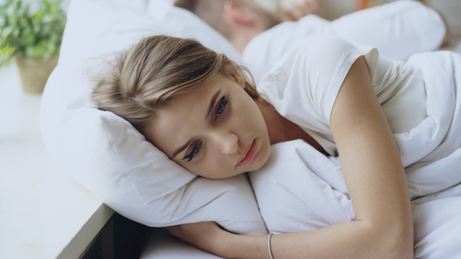 Woman in bed sad