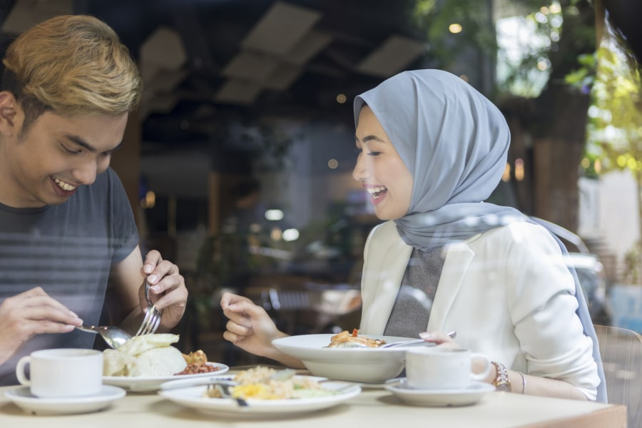 Muslim couple in the restaurant