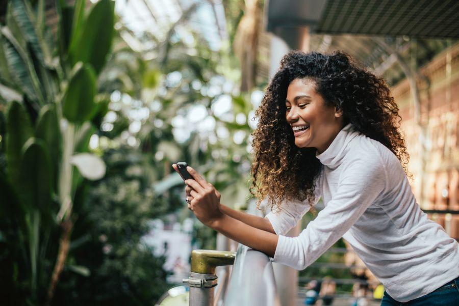 Interracial Dating Woman Browsing Phone